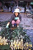 Young women selling roses in the streets of Hué.