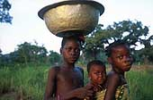 Benin 2001 - Perma gold mine. Children come back from the mine after a day of hard toil.