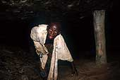 Benin 2001- Perma gold mine. Child exhausted by lack of air and high temperature.