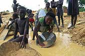 Benin 2001, Perma gold mine. Children searching gold for their parents or exploiters.