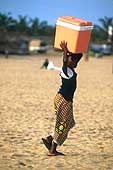 Benin 2001, Cotonu. Girl selling cool water on the seaside of Cotonu