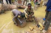 Benin 2001, Perma gold mine. Children looking for gold for their parents or exploiters.