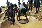 Benin 2001, Perma gold mine. Children look for gold in the river.
