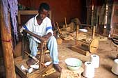 Benin 2001, Abomey. Child working at the loom of a workshop to produce fabric for tourists, near the former Royal Palace in Abomey.