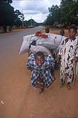 Benin 2001, Bohicon. Children working in the local market towing a cart.