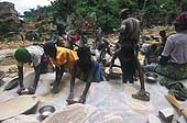 Benin 2001, Perma gold mine. Children smashing limestone containing gold.