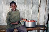 Child cook. Tanzania.