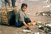 Child sorting out garbage
