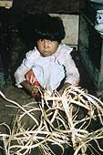 A six-year old girl working in a basketweaving factory