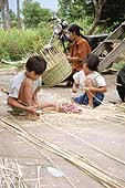 Children working in a basketwork factory