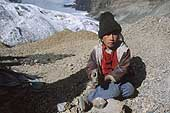 La Rinconada, child crushing gold bearing rocks