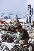 La Rinconada, child selecting gold bearing rocks