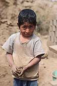 Huachipa, child collecting mud to make bricks