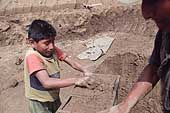 Huachipa, child working in a brick factory