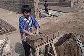 Huachipa, child preparing bricks