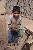 Huachipa, child collecting mud for bricks