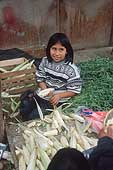 Lima, little girl working in a local market