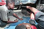 Young boy repairing a car, Abidjan