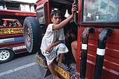 Young driver's assistant on a 'jeepney'