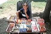 Kosovo, Gllogovc: young boy selling cigarettes in front of the city hospital