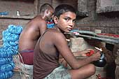 Boy working in the bangle industry, Ferozabad