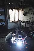 Arc welding, Okhla Flatted Factories Complex, New Delhi.