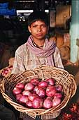 Young coolie in the vegetable market of Okhla, Delhi.