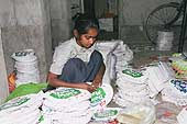 Sumitra (10 years old) packaging for Nestlé products, district of Okhla, New Delhi.