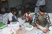 Sumitra (10 years old), Arif (7 years old) and Tajmamoud (9 years old) packaging for Nestlé products, district of Okhla, New Delhi.