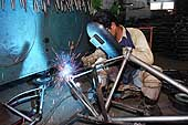 Bicycle industry: manufacturing and assembly line of ATLAS bicycles, soldering frames. ATLAS factory site in Haryana, India.