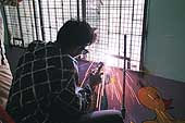 Welder working in the National Mental Health Institute NIMHANS in Bangalore.