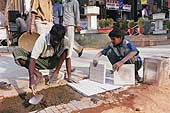Arun, 13 years old, works on construction sites with his father, Bangalore.