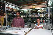 Liquor store open at night and a child employee as delivery boy, Bangalore.