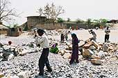 Child breaking rocks in a quarry in Faridabad, suburb of New Delhi.