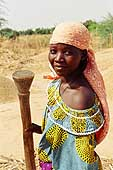 Young woman crushing millet. Village of Iskita (Tahoua area) Niger.