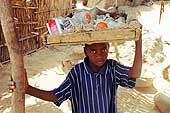 Young street seller in the camps by the goldmines of Komabangou. Niger.