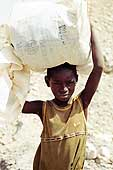 Child working as a gold searcher. Goldmines of Komabangou. Niger.