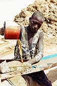 Washing ground stone to extract gold nuggets. Goldmines of Komabangou. Niger.