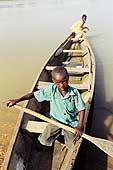 Moussa, young ferryman on the Niger river. Niamey.