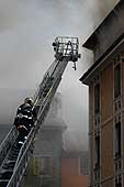 Firemen intervene in the old town of Annecy (France), 7 June 2003.