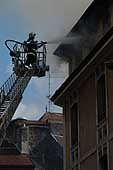 Firemen intervention in the old town of Annecy (France), 7 June 2003.