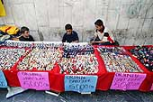 Young boys behind their array selling counterfeit watches. Turkey.
