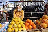 Young girl selling vegetables in a marketplace. Chisinau, Moldova.