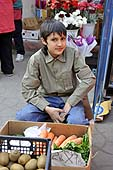 Young boy selling fruit and vegetables. Chisinau market place, Moldova.