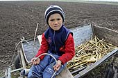 Young boy working the land. Orhei district, Moldova.