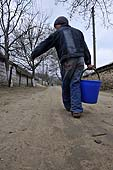 Young boy carrying water. Orhei district, Moldova.