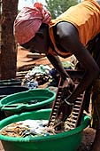 Young servant washing. Kita, Mali.