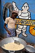 Young girl preparing food. Faladié area, Bamako, Mali.