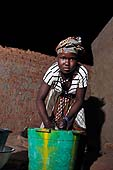 Young servant washing. Sévaré, Mali.