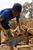Young boy working in a brickyard in Petaka, Mali.